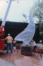 "Hal and his fabricators working with crane to erect his stainless steel sculpture ""Summer Fall Winter Spring!""  in reflecting pool."